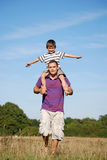 Father and son having fun together stock image