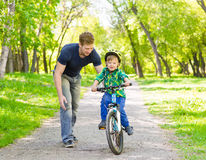 Father and son having fun weekend biking Royalty Free Stock Photography