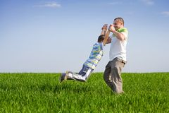 Father and son having good time outdoor. Father and son having a good time outdoor in wheat field Stock Images