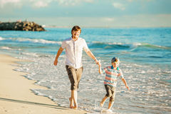 Father and son having great family time at ocean Royalty Free Stock Photo