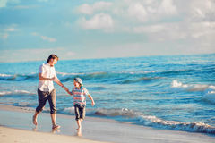 Father and son having great family time at ocean Royalty Free Stock Images