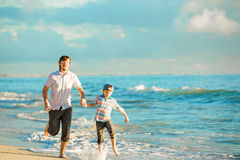 Father and son having great family time at ocean Royalty Free Stock Image