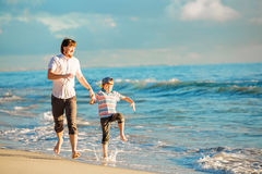 Father and son having great family time at ocean Royalty Free Stock Photography