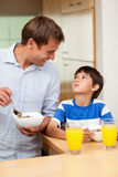 Father and son having healthy breakfast Royalty Free Stock Photos