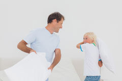 Father and son having a pillow fight Royalty Free Stock Photography