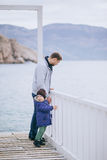 Father and son having a walk in a dock Stock Images