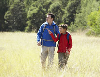 Father And Son On Hike In Beautiful Countryside Stock Photography