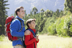 Father And Son On Hike In Beautiful Countryside Royalty Free Stock Photography