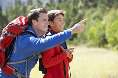 Father And Son On Hike In Beautiful Countryside Royalty Free Stock Photo