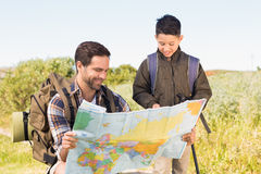 Father and son on a hike together Stock Images