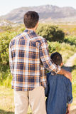 Father and son on a hike together Stock Photo