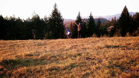 Father and son on a hike, top of the hill in autumn stock video footage