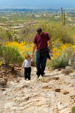 Father Son Hike Up Desert Mountain Stock Image