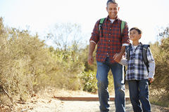 Father And Son Hiking In Countryside Stock Photography