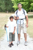 Father and son hiking Stock Image