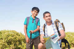 Father and son hiking in the mountains Stock Images