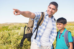 Father and son hiking in the mountains Royalty Free Stock Image