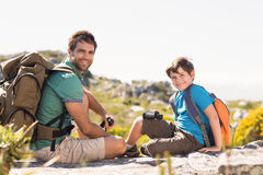 Father and son hiking through mountains Royalty Free Stock Photography