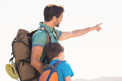 Father and son hiking through mountains Royalty Free Stock Photo