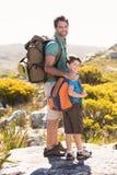 Father and son hiking through mountains Royalty Free Stock Photos