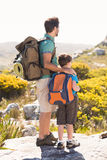 Father and son hiking through mountains Royalty Free Stock Images