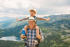 Father and son traveling in Rila mountains Bulgaria royalty free stock image