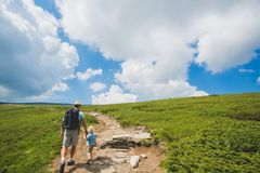 Father and son traveling in Rila mountains Bulgaria stock photos