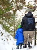 Father and son hiking in the snow. In a gorge in Germany Stock Photos