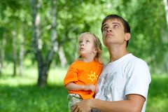 Father and son in his hands watching up outdoors Royalty Free Stock Images