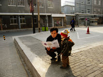 Father and son. A father and his son looking the map to find out where is the entrance of 798 art factory in beijing china Royalty Free Stock Image