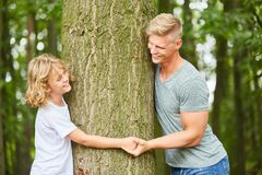 Father and son hold hands. On a trip in the forest royalty free stock photography