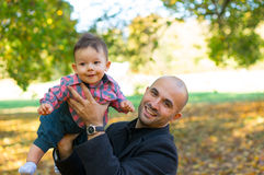 Father and son. Father holding baby at a park in the autumn Stock Photo