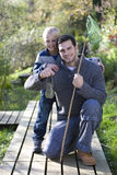 Father and son holding bug net and specimen jar outdoors Royalty Free Stock Images