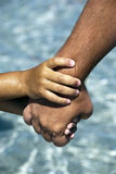 Father and son holding hands. Child holding father with two hands Stock Photography