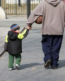 Father and son holding hands. And walking in the park Stock Image