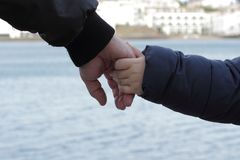 Father and son holding hands. Father and little son are holding hands, love and support Royalty Free Stock Photos