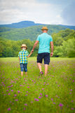 Father and son holding hands. Summer family time concept Stock Photo