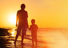 Father and son holding hands at sunset Royalty Free Stock Image