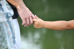 Father and son holding hands together Stock Image