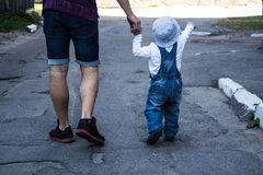 Father and son holding hands walking. In the city Stock Photography
