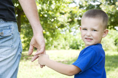 Father and son holding hands walking in the park Royalty Free Stock Photography