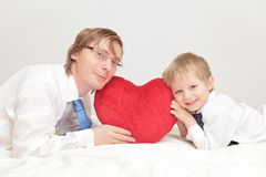 Father and son holding heart royalty free stock images