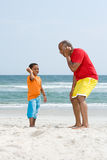 Father and son holding shells Stock Photo