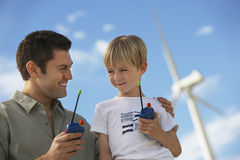 Father And Son Holding Toy Walkie-Talkies Royalty Free Stock Images