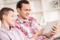 Father and son at home Royalty Free Stock Image