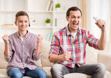 Father and son at home Stock Images