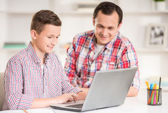 Father and son at home royalty free stock images