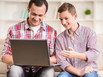Father and son at home Stock Photo