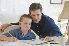 Father son homework Stock Photo