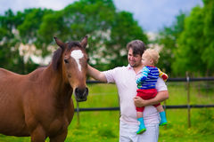 Father and son on a horse farm Royalty Free Stock Image